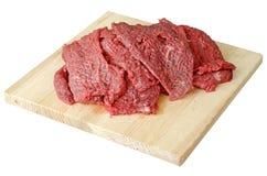 Carne - manzo su un bordo di taglio Fotografie Stock Libere da Diritti