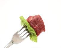 Carne na forquilha Fotos de Stock