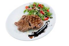 Carne na placa branca Imagem de Stock Royalty Free