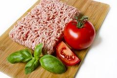 Carne picadita en una tarjeta de corte Foto de archivo libre de regalías