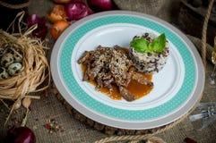 Carne picante en salsa con arroz imagen de archivo libre de regalías
