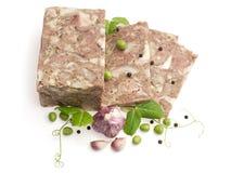 Carne pressionada das cabeças decoradas com alho? Foto de Stock