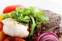 Carne saboroso no fundo branco Fotografia de Stock