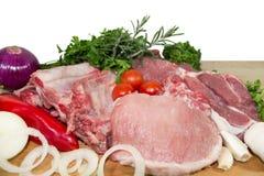 Carne sin procesar con los vehículos Imagen de archivo libre de regalías