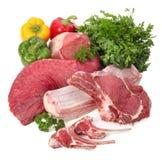 Carne sin procesar con los vehículos Fotografía de archivo libre de regalías