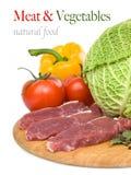 Carne sin procesar con pimientas Imagen de archivo
