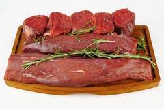 Carne sin procesar con romero Fotografía de archivo libre de regalías