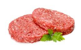 Carne sin procesar de la hamburguesa en blanco Imágenes de archivo libres de regalías