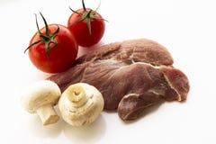 Carne sin procesar en blanco Imagen de archivo