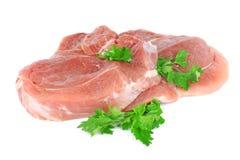 Carne sin procesar fresca con verdes Fotos de archivo libres de regalías