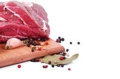 Carne y especia crudas Foto de archivo