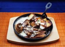 Carne y patatas fritas Fotos de archivo