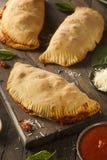 Carne y queso italianos hechos en casa Calzones Fotografía de archivo