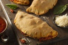Carne y queso italianos hechos en casa Calzones Fotos de archivo libres de regalías