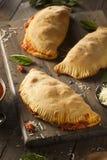 Carne y queso italianos hechos en casa Calzones Imagen de archivo