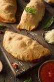 Carne y queso italianos hechos en casa Calzones Fotos de archivo
