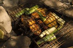 Carne y vehículos asados a la parilla Imagen de archivo libre de regalías
