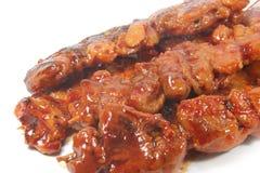 Carnes asadas a la parilla Foto de archivo libre de regalías