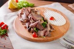 Carnes finas com ervas e molho Foto de Stock