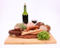 Carnes frias e vinho Imagens de Stock Royalty Free