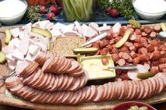 Carnes y queso rebanados Imágenes de archivo libres de regalías
