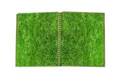 Carnet avec la page d'herbe verte Photographie stock