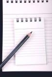 Carnet avec le crayon Image libre de droits
