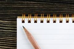 Carnet avec le crayon Photos libres de droits