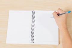 Carnet d'écriture de main avec le stylo Photos stock