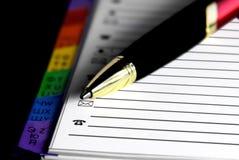 Carnet d'adresses et crayon lecteur de bille Image libre de droits