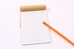 Carnet et crayon Images libres de droits