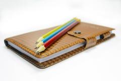 Carnet et crayons Photographie stock