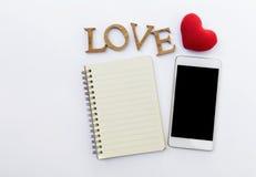 Carnet et smartphone vides Photo libre de droits
