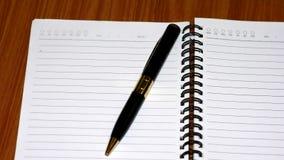 Carnet et stylo image libre de droits