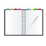 Carnet et stylo Photographie stock