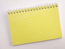 Carnet ordonné par jaune de chiquenaude 2 image stock