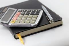 Carnet, stylo, calculatrice Photo stock