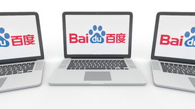 Carnets avec le logo de Baidu sur l'écran Rendu conceptuel de l'éditorial 3D d'informatique Photographie stock