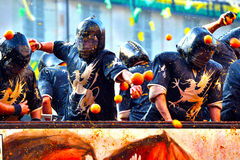 Carnevale d' ivrea. Immage captured during the orange battle in Ivrea Royalty Free Stock Image