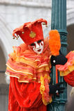 Carnevale di Venezia. Venetian mask and costume of red joker