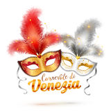 Carnevale di Venezia sign and two bright carnival Stock Image