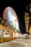Carnevale frantumato con una rotella di ferris Immagini Stock Libere da Diritti