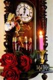 Carnevale, simbolo del giullare della maschera di trasformazione, cambiamento e mistero, simbolo dell'orologio di tempo, rievocat fotografia stock
