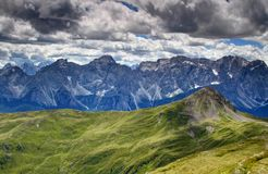 Carnic Alps green hills with limestone wall of Sexten Dolomites Stock Photos