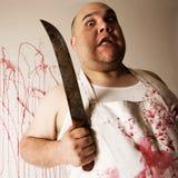 Carnicero enojado con el cuchillo imagen de archivo