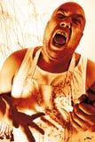 Carnicero insano Imagenes de archivo