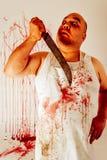Carnicero psico loco Imagen de archivo libre de regalías