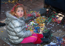 Carnival 2011 in Breda (Netherlands). Breda, North-Brabant, Netherlands – March 7, 2011 – Carnival Parade,  impression of the people, little girl sitting on Stock Photos