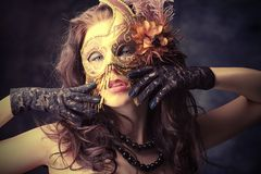 Carnival. Portrait of an attractive woman in mask posing at studio stock image