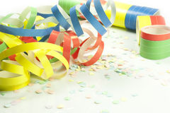 Carnival. Colored streamers and colorful confetti Royalty Free Stock Photo